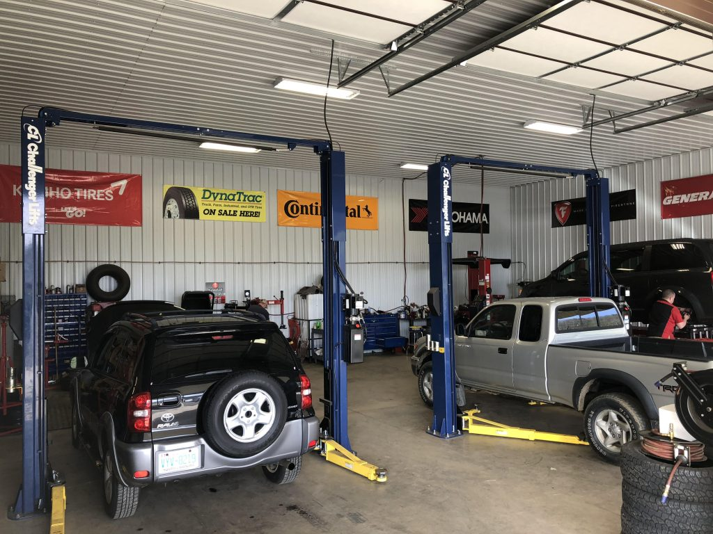 Multiple Cars Being Repaired at P & M Tire